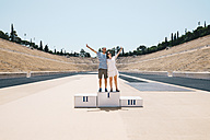 Greece, Athens, couple on the podium celebrating in the Panathenaic Stadium - GEMF01419