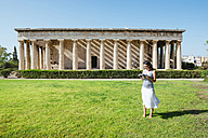 Greece, Athens, woman reading a book in front of The Hephaisteion in the Agora - GEMF01440