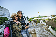 Two happy young women on a trip - KIJF01112