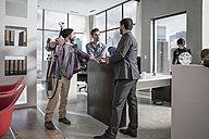Businessman and staff talking in modern office - ZEF12498