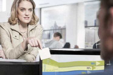 Young woman in office looking at colleague - ZEF12513
