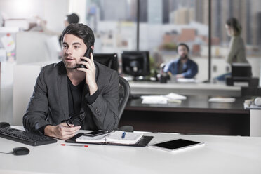 Businessman on the phone in office - ZEF12540