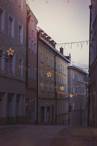 Germany, Passau, Christmas illumination between houses in the old town - JUNF00782