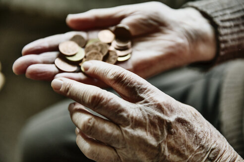 Senior woman's hands with coins - JATF00945