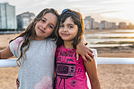 Portrait of two best friends on the beach at sunset - MGO02827