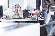 Woman on the phone in office - ZEF12597