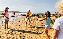 Group of children playing on the beach with ball - MGOF02834