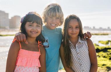 Portrait of three children on the beach - MGOF02843