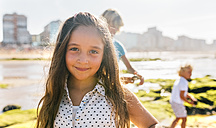 Portrait of little girl on the beach - MGOF02846