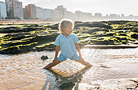 Little boy playing on the beach - MGOF02855