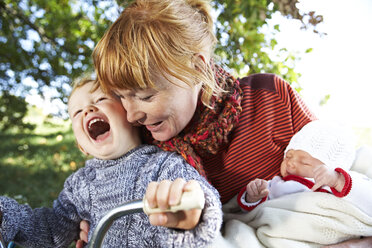 Happy mother with son and baby in the nature - FSF00674