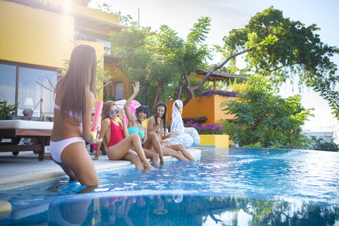 Four young women having fun at the poolside - ABAF02143