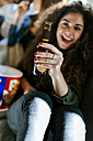 Woman toasting with beer bottle - VABF01084