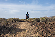 Spain, Tenerife, back view of hiking man - SIPF01391