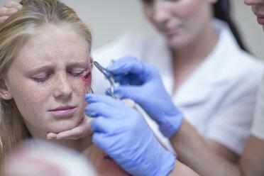 Injured girl getting treatment in hospital - ZEF12616