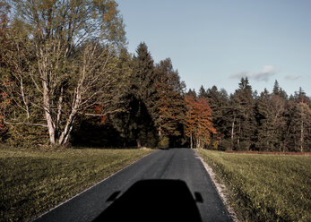 Shadow of people carrier on country road in autumn - WVF00827