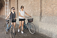 Two young women pushing their bikes - ALBF00084