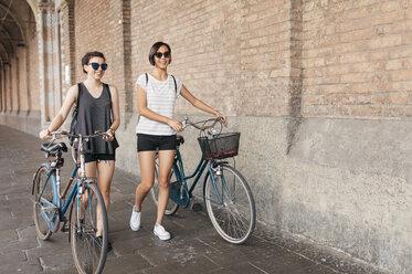 Two young women pushing their bikes - ALBF00084