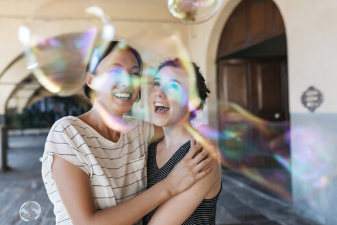 Two young women playing with soap bubbles - ALBF00123