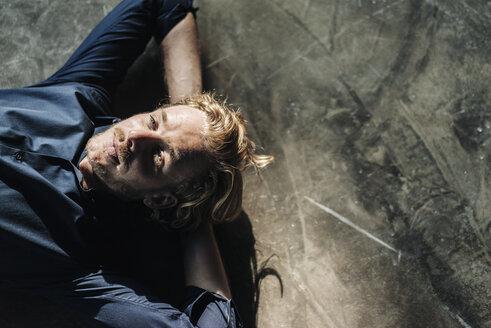 Man lying on floor looking up - KNSF00882