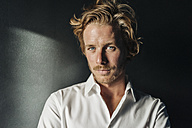 Portrait of confident blond man wearing white shirt - KNSF00945