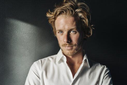 Portrait of confident blond man wearing white shirt - KNSF00945