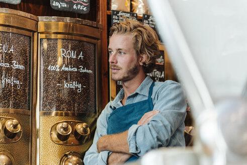 Coffee roaster in his shop - KNSF00948
