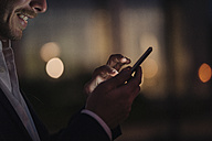 Close-up of businessman text messaging - KNSF00996