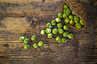 Brussels sprouts and wickerbasket on dark wood - LVF05837