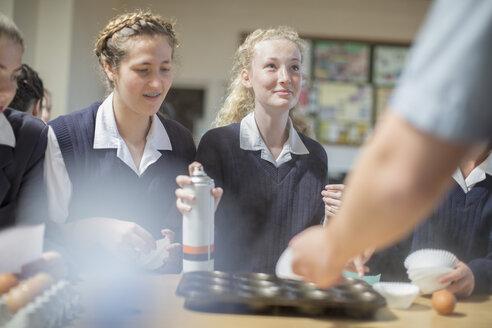 Teenage girls in high school cooking class - ZEF12634