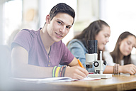 Portrait of smiling science student in class - ZEF12646