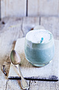 Glass of blue coloured latte with spirulina algae, vegan plant milk, ginger and rice syrup - SBDF03148