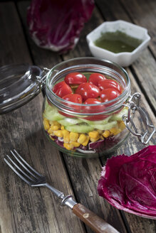 Preserving jar of salad with different vegetables - YFF00634