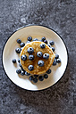 Dish with pile of pancakes and blueberries with maple sirup - SARF03167