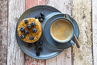 Dish with pancakes, blueberries with maple sirup and a cup of black coffee - SARF03170