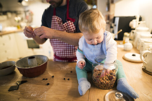Father and baby boy in kitchen baking a cake - HAPF01345