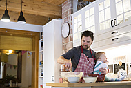 Father and baby boy in kitchen baking a cake - HAPF01348