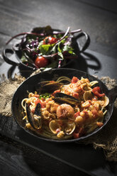 Spaghetti Frutti di Mare with leaf spinach lettuce dish - MAEF12113