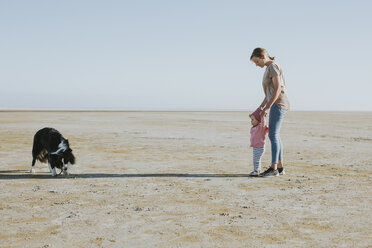 Netherlands, Schiermonnikoog, mother walking with little daughter on the beach at low tide - DWF00269