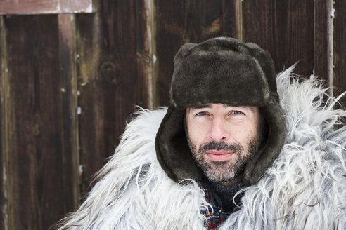Portrait of man wearing fur cap in winter - FSF00733