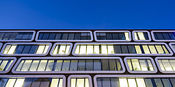 Part of facade of lighted office building in the evening - WDF03864