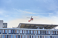 Germany, Ulm, rescue helicopter landing on roof top of university hospital - JED00280