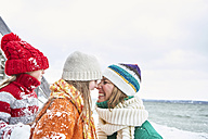 Mother and daughters having fun in winter - FSF00750