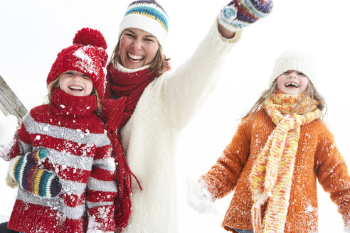 Mother and daughters having fun in winter - FSF00768