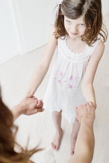 Little girl holding mothers ands - JATF00950