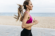 Young woman running at the beach - GIOF01722