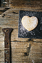 Heart-shaped Shortbread sprinkled with icing sugar on slate and wood - GIOF01794