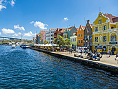 Curacao, Willemstad, Punda, colorful houses at waterfront promenade - AM05247