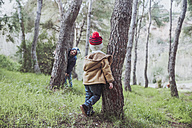 Two boys playing in forest - RTBF00641