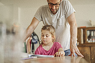Father checking homework of his daughter - JOSF00481